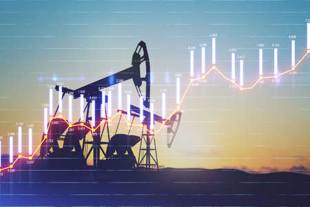 Rise in gasoline prices concept with double exposure of digital screen with growing financial chart candlestick and oil pumps on a field