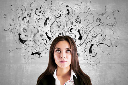 Business decision concept with black arrows directed in different directions on concrete wall behind woman head