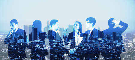 Many entrepreneurs standing and thinking with a city view in the background, teamwork and partnership concept, double exposure