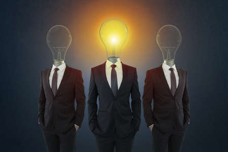 Light bulb headed businessmen in suits