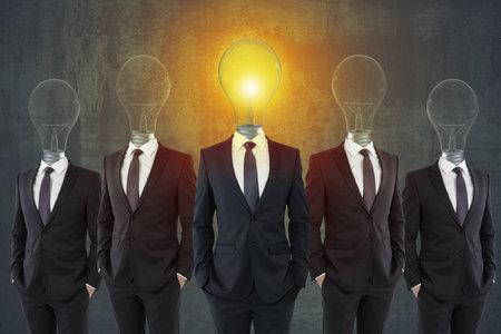 Lamp headed businessmen in suits