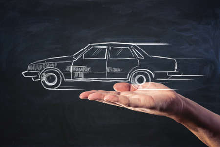 Car booking and car sharing service concept with handwritten automobile on man palm with dark background 免版税图像