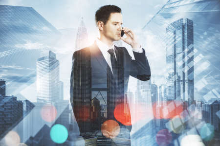 Success concept with handsome businessman talking by smartphone