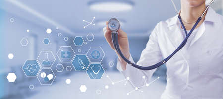 Doctor with stethoscope with digital medical interface.