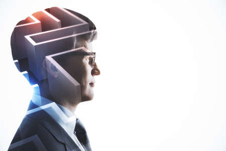 Personal development and brainstorming concept with piece of maze in businessman head