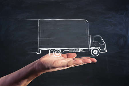 Delivery service and moving concept with handwritten truck on human palm