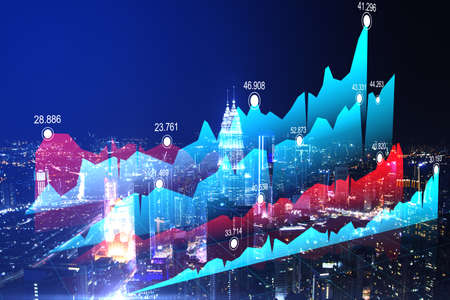 Creative business chart on glowing night city backdrop. 免版税图像