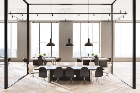 Front view on meeting table in conference room with glass walls in sunny office hall with modern interior design