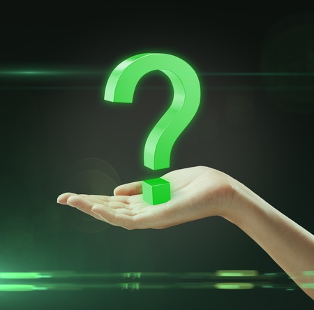 Green question mark on a hand Stock Photo - 10224278