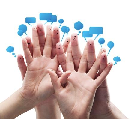dedo: Feliz grupo de smileys de dedo con burbujas de inicio de sesi�n y discurso social chat.Aislado en un fondo blanco Foto de archivo