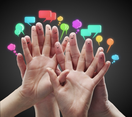 Happy group of finger smileys with social chat sign and speech bubbles photo