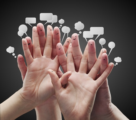 communication concept: Happy group of finger smileys with social chat sign and speech bubbles