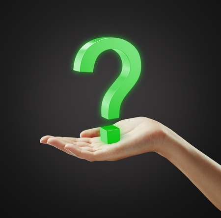 Green question mark on a hand Stock Photo - 10299167