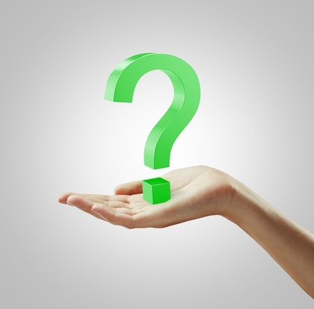 unanswered: Green question mark on a hand Stock Photo