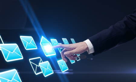 Young business man pressing a envelope touchscreen button photo