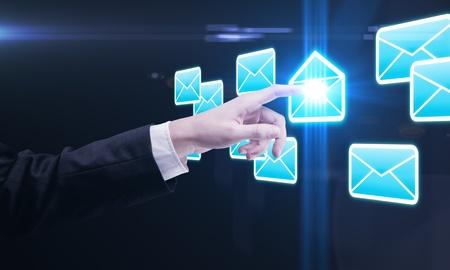 hightech: Young business man pressing a envelope touchscreen button Stock Photo