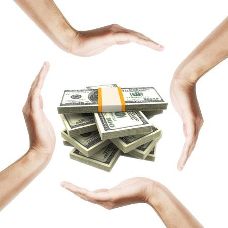 cash in hand: Billetes de d�lar con manos humanas alrededor de ella. Aisladas sobre fondo blanco.