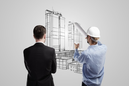 Architect is showing a project of building to the director photo