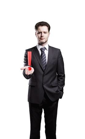 Young  businessman with an exclamation mark on his hand. Isolated on a white background photo