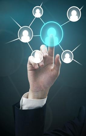 Man hand pressing Social Network icon Stock Photo - 10868310