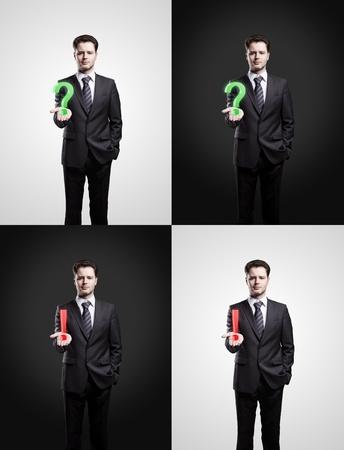 onbeantwoorde: Set van jonge businessmans met een vraag-en uitroeptekens op zijn hand