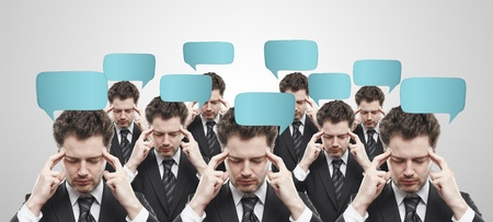 open minded: Group of businessmen with social chat sign and speech bubbles. Thinking men representing a social network.  Conceptual image of a open minded men.On a gray background Stock Photo