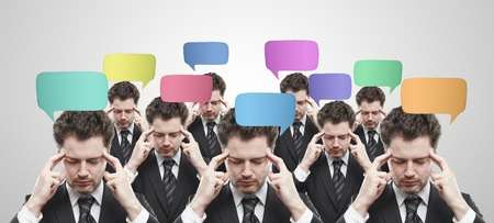 Group of businessmen with social chat sign and speech bubbles. Thinking men representing a social network.  Conceptual image of a open minded men.On a gray background photo
