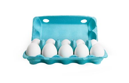 Ten white eggs in a carton box. Isolated on a white background photo