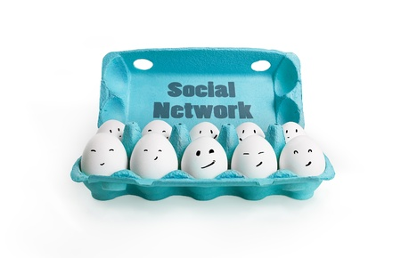 egg carton: Group of happy eggs with smiling faces representing a social network. Ten white eggs in a carton box.  Isolated on a white background Stock Photo