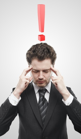 open minded: Portrait of a young man with red exclamation mark above his head. Conceptual image of a open minded man. Stock Photo