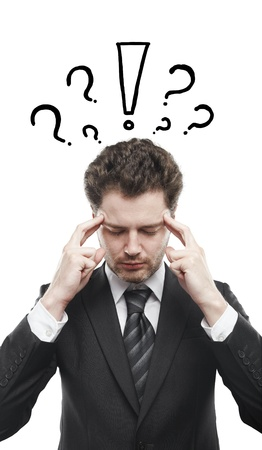 Portrait of a young man with exclamation mark and question marks above his head. Conceptual image of a open minded man.  photo