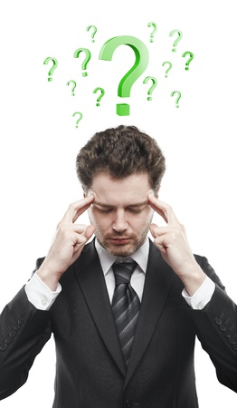 unanswered: Portrait of a young man with green question marks above his head.Conceptual image of a open minded man. Isolated on a white background