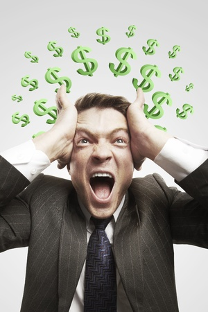 Portrait of a young man shouting loud with green question marks above his head. Conceptual image of a open minded man. On a gray background Stock Photo - 11286187