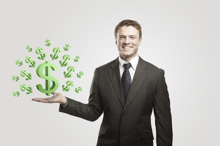 Young  businessman chooses a green US dollar signs.On a gray background  photo
