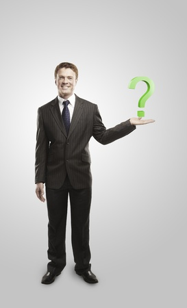 Young  businessman with a question mark on his hand. On a gray background  photo