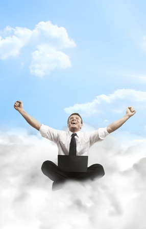 excited people: Happy young businessman with laptop sitting on the clouds. Stock Photo
