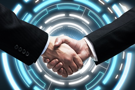 hightech: Handshake - Hands holding on background  a touch screen interface Stock Photo
