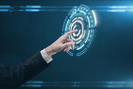 hightech: Hand pushing a button on a touch screen interface. Man pressing a touchscreen button Stock Photo