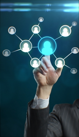 Young business man pressing a touchscreen Social Network button Stock Photo - 11499149