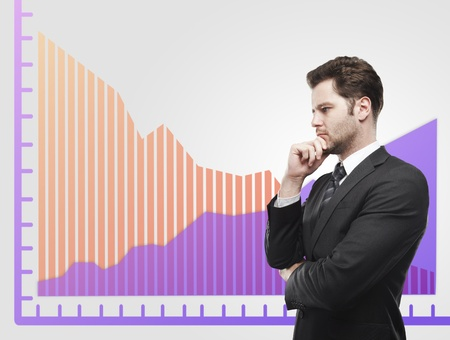 dynamic growth: Young business man look at a graphs showing rise and fall in profits or earnings, falling orange. Financial diagrams.  Rising arrow, representing business growth. On a gray background