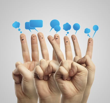 Happy group of finger smileys with social chat sign and speech bubbles. Fingers representing a social network. Stock Photo - 11788941