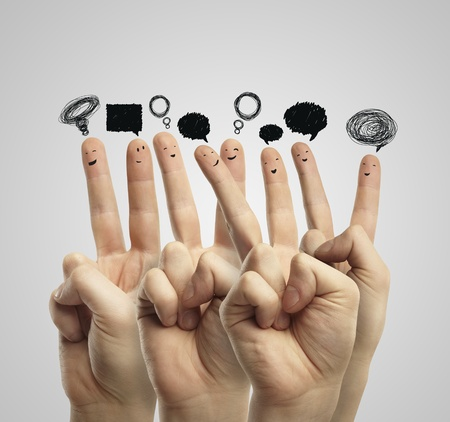 Happy group of finger smileys with social chat sign and speech bubbles. Fingers representing a social network. Stock Photo - 11788948