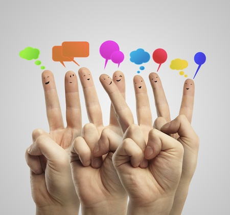 Happy group of finger smileys with social chat sign and speech bubbles. Fingers representing a social network. Stock Photo - 11788976