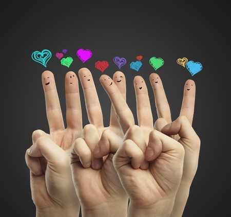 Group of happy finger smileys with love heart speech bubbles and social chat sign. photo