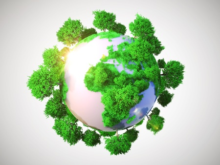 Model of Earth with oversized trees  Miniature planet with sparse leafy tree vegetation  Conceptual symbol of the Earth on a gray background photo