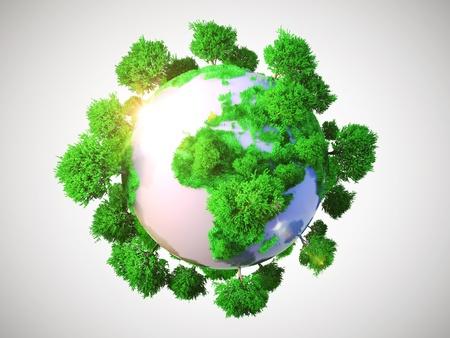 green planet: Modelo de la Tierra con el planeta de gran tama�o en miniatura, con escasos �rboles s�mbolo de frondosa vegetaci�n arb�rea conceptual de la Tierra sobre un fondo gris Foto de archivo