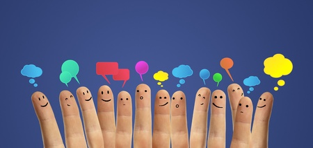 Happy group of finger smileys with social chat sign and speech bubbles  Fingers representing a social network  photo