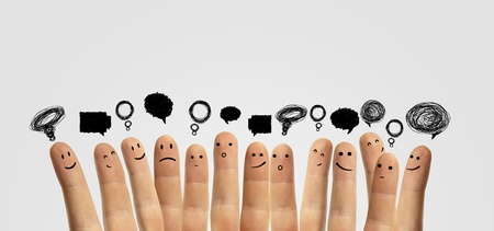 social network: Happy group of finger smileys with social chat sign and speech bubbles  Fingers representing a social network  Stock Photo