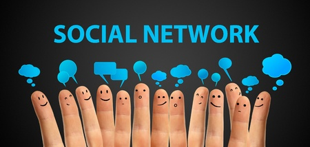 creative ideas: Happy group of finger smileys with social chat sign and speech bubbles  Fingers representing a social network  Stock Photo