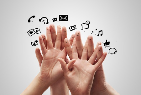 Happy group of finger smileys with social chat sign and speech bubbles,icons  Fingers representing a social network  Stock Photo - 13366210